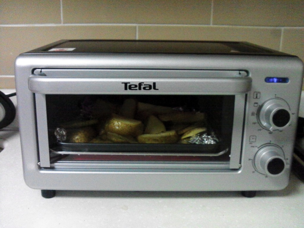 My mini oven...Potatoes are baking!