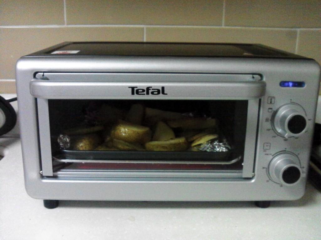 My mini oven...Potatoes are baking!