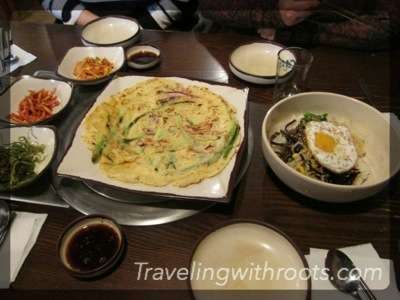 A Korean pancake and other foods.